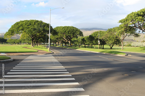 Stampa su Tela A view of an empty street intersection with the crosswalk, Kapolei, Oahu, Hawaii