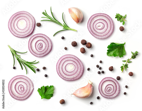 red onion and spices on white background