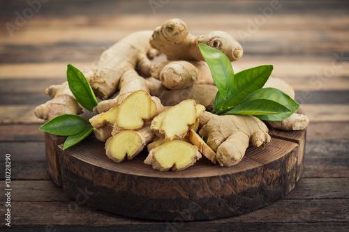 Fotografija Fresh ginger root on the wooden table