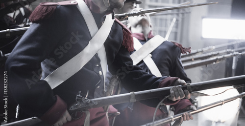 medieval soldier being shot in an attack surrounded by muskets in a revolutionar Fototapet