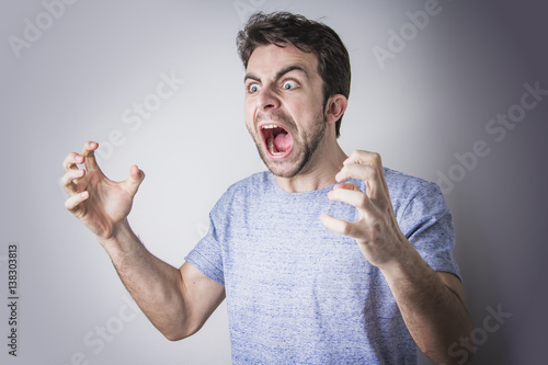 Photographie Angry man yelling and shouting in rage, crazy and mad