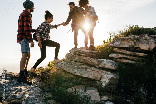 Group of friends hiking in mountain