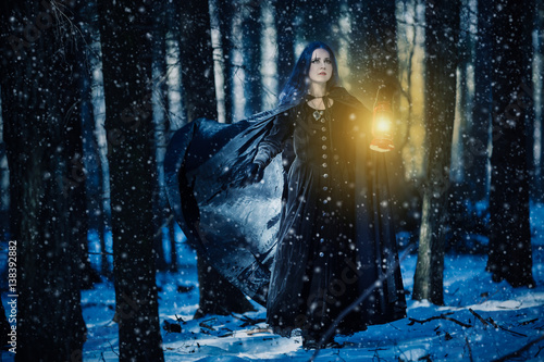 Sorceress and the lamp in the magic forest Fototapeta