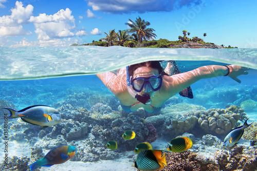 Tablou Canvas Young woman at snorkeling in the tropical water