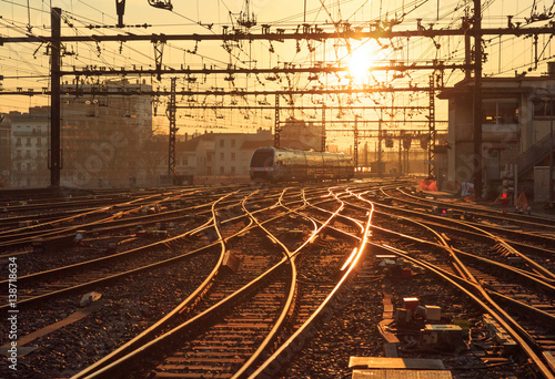 A train on the railroad tracks at Perrache station in Lyon (Gare de Lyon-Perrache), France, during sunrise.