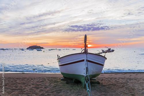 fishing boat on the coast of Tossa de Mar, Spain Fototapeta