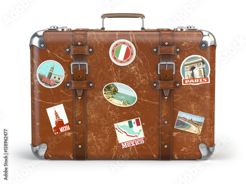 Fotografia Old suitcase baggage with travel stickers isolated on white background
