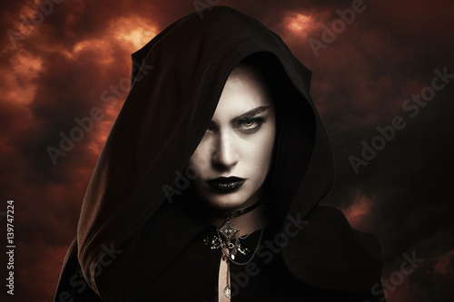 Dark witch and hellish sky Fototapeta