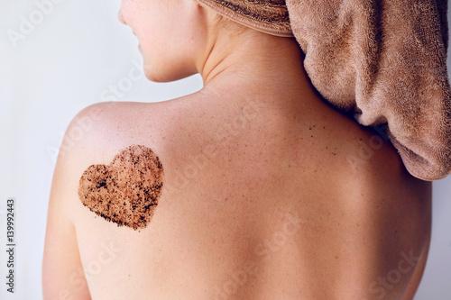 Obraz na plátně Close up woman body care scrub on back. Bath treatments