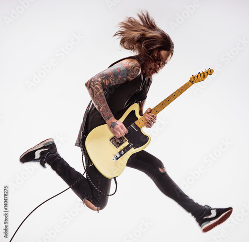 Fotografie, Obraz Guitarist plays guitar.