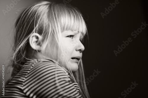 Leinwand Poster Sad crying child.