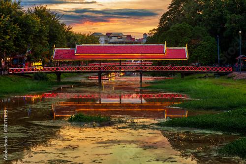 Fototapeta premium Bright bridge over Siem Reap river at dusk. Siem Reap, Cambodia