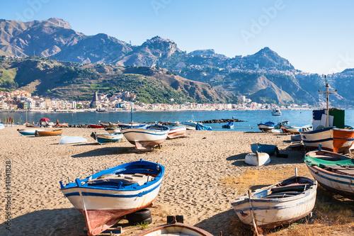boats on urban beach in giardini naxos town фототапет