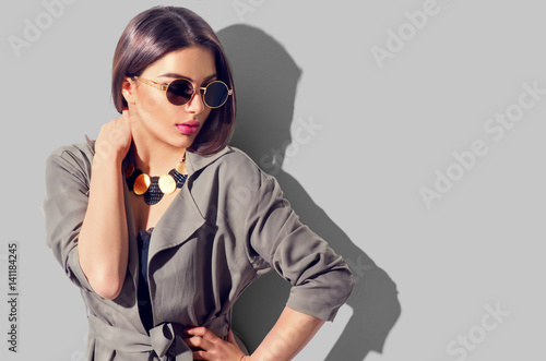 Beauty fashion brunette model girl with perfect makeup, trendy accessories and fashion wear