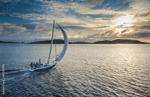 Obraz na płótnie Sailing boat with spinnaker sail on open sea