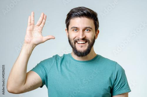 Fotografia Man making Vulcan salute isolated