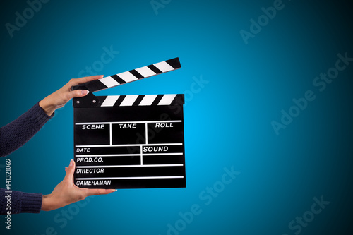 Fotografia Clapperboard sign hold by female hands.
