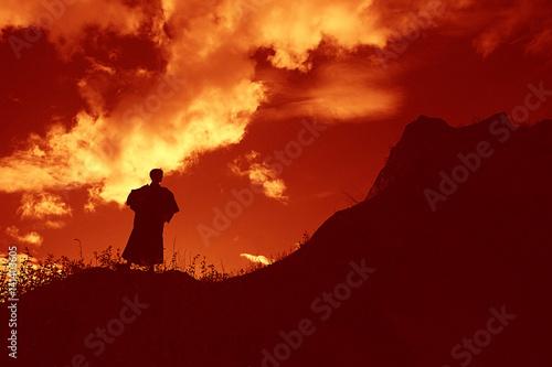 Fotografia, Obraz Silhouette monk on the mountain prayer moses faith god