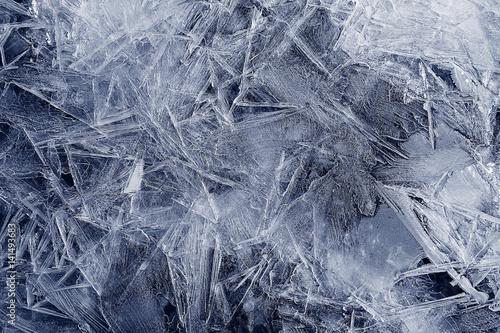 Valokuvatapetti Transparent ice crystals texture cracked background