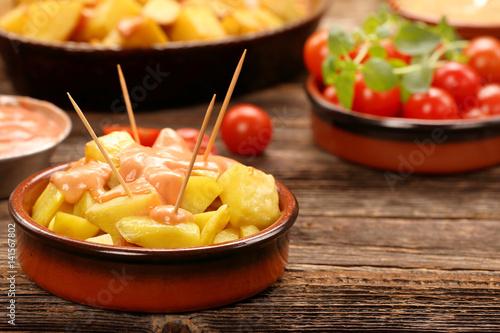 Fotografiet Patatas bravas traditional Spanish potatoes snack tapas