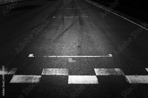 Photo Start and Finish, Front line of asphalt street with sign of start and finish line on road, Black abstract texture and background
