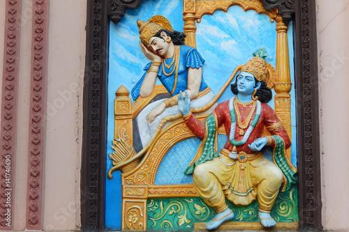 Wall art of Krishna tell Bhagavad gita to Arjuna in Mahabharata war as in Hindu epic in temple