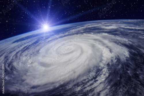 Giant cyclone on the planet Earth due to the global warming that will cause an increase in temperature and rainfall. Elements of this image furnished by NASA
