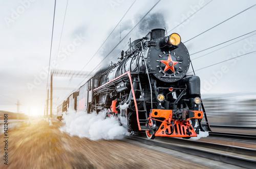 Photo Vintage black steam locomotive train rush railway