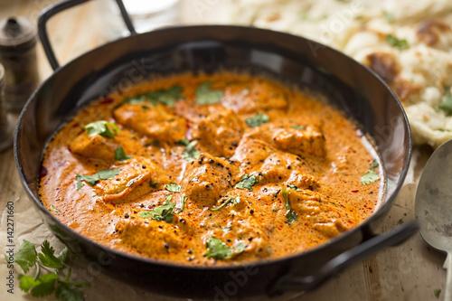 Canvas-taulu Butter chicken curry with tender chicken breast, cream, butter & honey