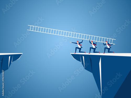 Business team using ladder to cross through the gap between hill Fotobehang
