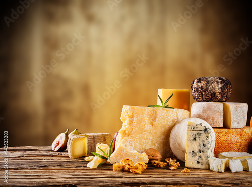 Various kind of cheese served on wood