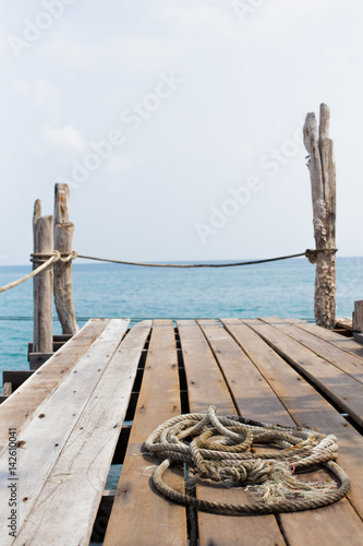 Rope on wood dock by the sea in Thailand
