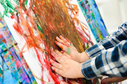 Vászonkép Mother and child draw a picture paints, art lesson
