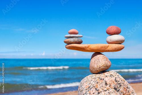 Concept of harmony and balance. Balance stones against the sea. Fototapeta