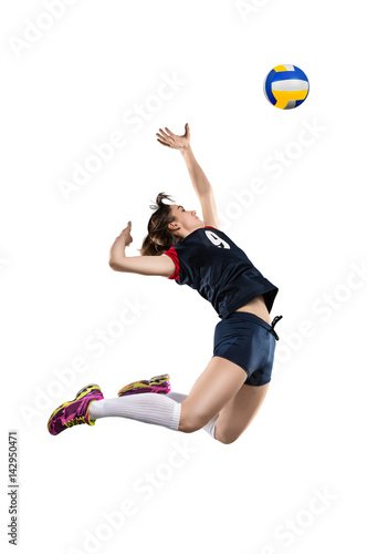 Female volleyball player hitting the ball