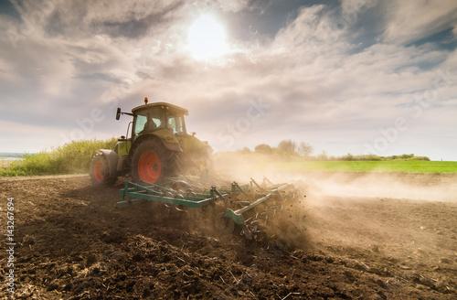 Canvas Print Tractor preparing land