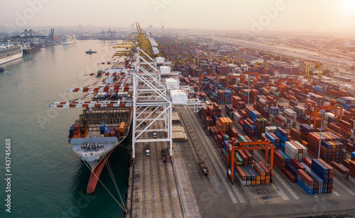 Tablou Canvas Ship for container with working crane bridge in shipyard for Logistic Import Exp