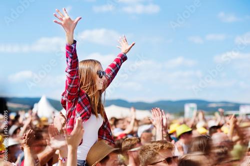 Teenagers at summer music festival enjoying themselves Fototapeta
