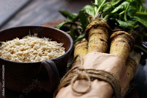 Canvastavla raw horseradish roots on wooden background