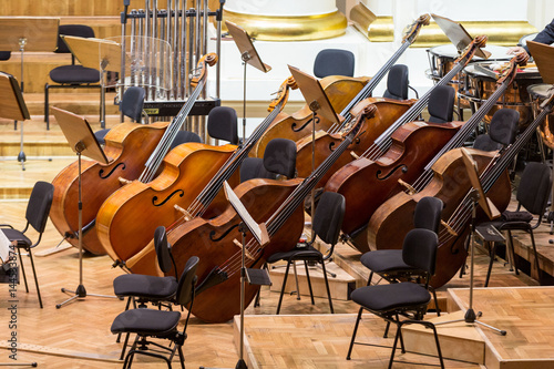 Vintage, music instruments, old bass viols on stage