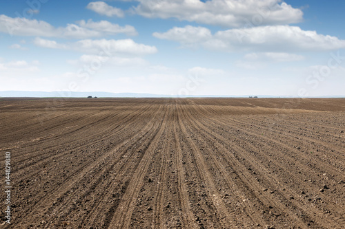 Canvas Print plowed field  country landscape spring season agriculture