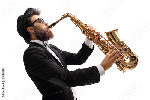 Man in a suit playing on a saxophone Fototapeta
