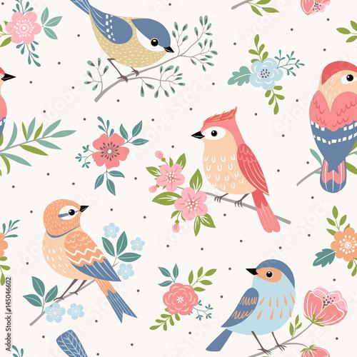 Bezszwowy pastelowy wzór ptaki z kwiecistymi elementami na kropki tle.