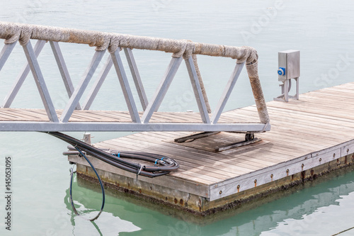 Slope walkway to the wooden dock of Fisherman village.