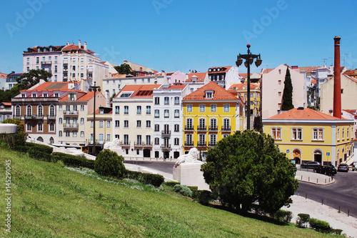 Canvas Print Lisbon architecture. Colorful houses against the blue sky