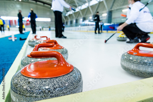 Valokuva Curling stone on a game sheet.