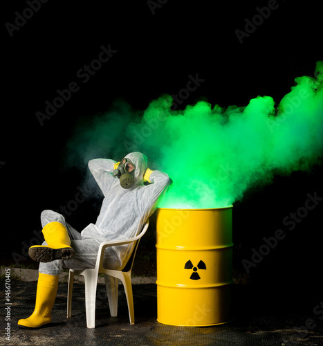 Stampa su Tela biohazard worker and radioactive green smoke coming out from yellow barrel
