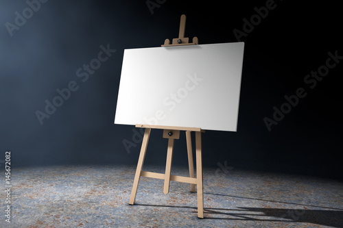 Wallpaper Mural Wooden Artist Easel with White Mock Up Canvas in the volumetric light