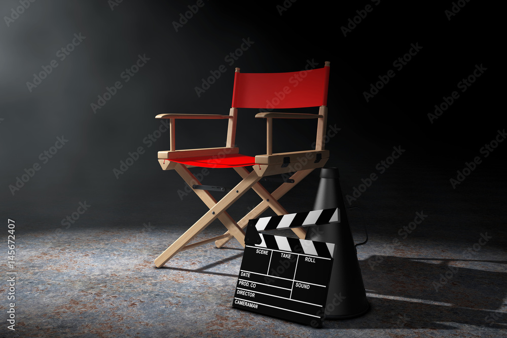 Cinema Industry Concept. Red Director Chair, Movie Clapper and Megaphone in the volumetric light. 3d Rendering