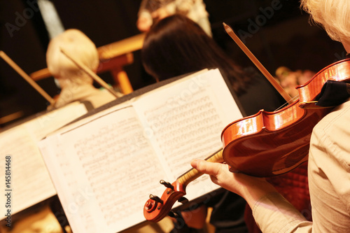 Woman playing the violin. Rehearsal Symphony orchestra.